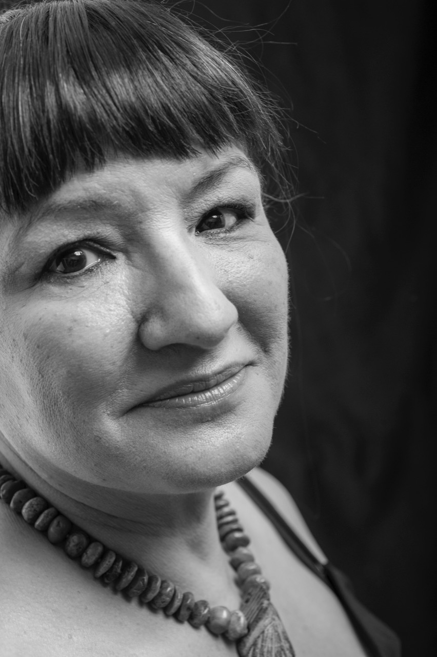Sandra Cisneros appears in black and white and close up and looks at the camera.