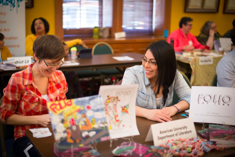 Image of two people sitting at a table at the 2016 Social Change Book Fair